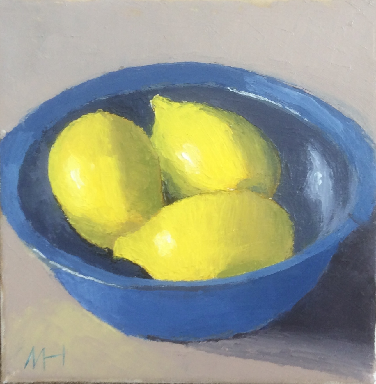 Three lemons in a bowl